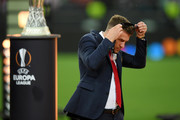Aaron Ramsey of Arsenal removes his runners up medal following his team's defeat in the UEFA Europa League Final between Chelsea and Arsenal at Baku Olimpiya Stadionu on May 29, 2019 in Baku, Azerbaijan.