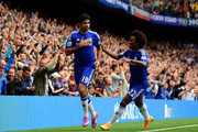 Diego Costa #19 of Chelsea is congratiulated by teammate Willian of Chelsea after scoring his team's second goal during the Barclays Premier League match between Chelsea and Aston Villa at Stamford Bridge on September 27, 2014 in London, England.