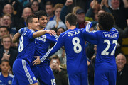Diego Costa of Chelsea celebrates scoring opening goal with team mates during the Barclays Premier League match between Chelsea and West Bromwich Albion at Stamford Bridge on November 22, 2014 in London, England.