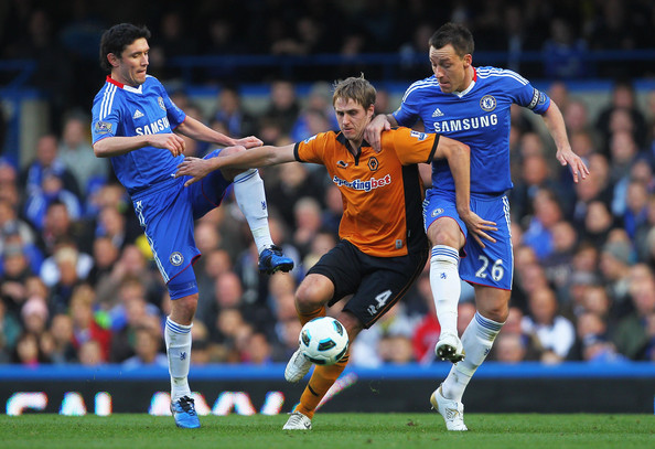 Dave Edwards of Wolverhampton Wanderers is closed down by Yury Zhirkov (L) and John Terry of Chelsea during the Barclays Premier League match between Chelsea and Wolverhampton Wanderers at Stamford Bridge on October 23, 2010 in London, England.