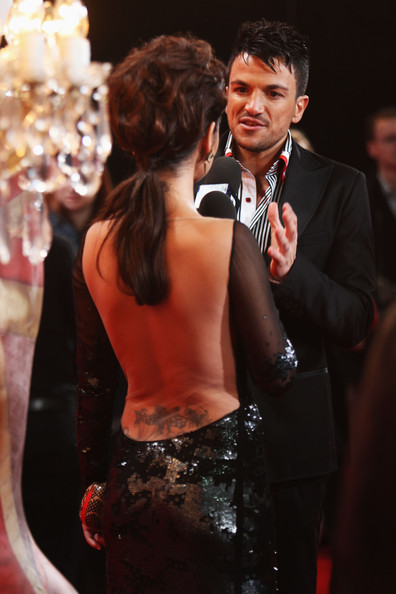 Cheryl Cole (UK TABLOID NEWSPAPERS OUT) Peter Andre talks to Cheryl Cole as she arrives for The Brit Awards 2011 held at The O2 Arena on February 15, 2011 in London, England.