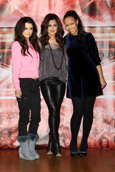 Cheryl Cole (UK TABLOID NEWSPAPERS OUT) L-R Cher Lloyd, Cheryl Cole and Rebecca Ferguson pose for a photocall to promote the X-Factor final held at The Connaught Hotel on December 9, 2010 in London, England.