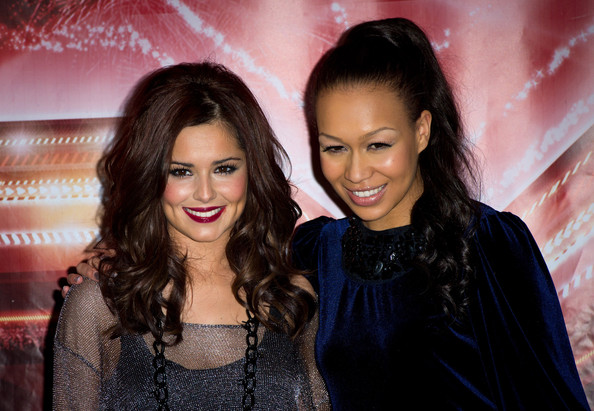Cheryl Cole Cheryl Cole and Rebecca Ferguson attend a photocall during the X Factor press conference at the Connaught Hotel on December 9, 2010 in London, England.