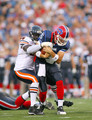 Trent Edwards #5  of the Buffalo Bills is tackled by Alex Brown #96 of  the Chicago Bears on August 15, 2009 at Ralph Wilson Stadium in Orchard Park, New York.