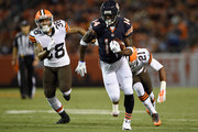 Santonio Holmes #14 of the Chicago Bears carries the ball ahead of Aaron Berry #38 and Justin Gilbert #21 of the Cleveland Browns during the second quarter at FirstEnergy Stadium on August 28, 2014 in Cleveland, Ohio.