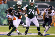 Running back Chris Ivory #33 of the New York Jets carries the ball as defensive tackle Stephen Paea #92 of the Chicago Bears defends during a game at MetLife Stadium on September 22, 2014 in East Rutherford, New Jersey.