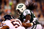 Running back Chris Ivory #33 of the New York Jets carries the ball as inside linebacker Jon Bostic #57 of the Chicago Bears tries to make the tackle during a game at MetLife Stadium on September 22, 2014 in East Rutherford, New Jersey.