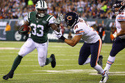 Running back Chris Ivory #33 of the New York Jets carries the ball as cornerback Isaiah Frey #31 of the Chicago Bears defends during a game at MetLife Stadium on September 22, 2014 in East Rutherford, New Jersey.