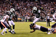 Running back Chris Ivory #33 of the New York Jets carries the ball as strong safety Danny McCray #29 of the Chicago Bears tries to make the tackle during a game at MetLife Stadium on September 22, 2014 in East Rutherford, New Jersey.