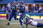 Tight end Jimmy Graham #88 of the Seattle Seahawks rushes against defensive end Pernell McPhee #92 of the Chicago Bears at CenturyLink Field on September 27, 2015 in Seattle, Washington. The Seahawks defeated the Bears 26-0.