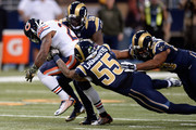 Ka'Deem Carey #25 of the Chicago Bears is tackled by James Laurinaitis #55 of the St. Louis Rams in the second quarter at the Edward Jones Dome on November 15, 2015 in St. Louis, Missouri.
