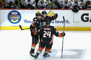 Cam Fowler #4 of the Anaheim Ducks celebrates his first period goal against the Chicago Blackhawks with teammates Sami Vatanen #45 and Simon Despres #24 in Game Five of the Western Conference Finals during the 2015 NHL Stanley Cup Playoffs at Honda Center on May 25, 2015 in Anaheim, California.