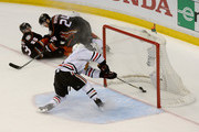 Duncan Keith #2 of the Chicago Blackhawks reaches into the goal after Jakob Silfverberg #33 of the Anaheim Ducks score an empty net goal in the third period of Game One of the Western Conference Finals during the 2015 NHL Stanley Cup Playoffs at Honda Center on May 17, 2015 in Anaheim, California.