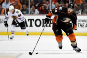 Simon Despres #24 of the Anaheim Ducks with the puck ahead of Patrick Kane #88 of the Chicago Blackhawks in the first period in Game Seven of the Western Conference Finals during the 2015 NHL Stanley Cup Playoffs  at the Honda Center on May 30, 2015 in Anaheim, California.
