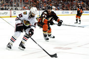 Johnny Oduya #27 of the Chicago Blackhawks with the puck against Simon Despres #24 of the Anaheim Ducks in the third period in Game Seven of the Western Conference Finals during the 2015 NHL Stanley Cup Playoffs  at the Honda Center on May 30, 2015 in Anaheim, California.