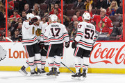 Richard Panik #14 of the Chicago Blackhawks celebrates his first period goal against the Ottawa Senators with teammates Connor Murphy #5, Michal Kempny #6, Tommy Wingels #57 and Lance Bouma #17 at Canadian Tire Centre on January 9, 2018 in Ottawa, Ontario, Canada.