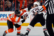 Pierre-Edouard Bellemare #78 of the Philadelphia Flyers fights with Daniel Carcillo #13 of the Chicago Blackhawks during the third period  at the Wells Fargo Center on March 25, 2015 in Philadelphia, Pennsylvania.  The Flyers defeated the Blackhawks 4-1
