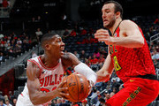 Kris Dunn #32 of the Chicago Bulls drives against Miles Plumlee #18 of the Atlanta Hawks at Philips Arena on March 11, 2018 in Atlanta, Georgia.  NOTE TO USER: User expressly acknowledges and agrees that, by downloading and or using this photograph, User is consenting to the terms and conditions of the Getty Images License Agreement.