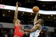 Kemba Walker #15 of the Charlotte Hornets drives to the basket against Kris Dunn #32 of the Chicago Bulls during their game at Spectrum Center on October 8, 2018 in Charlotte, North Carolina. NOTE TO USER: User expressly acknowledges and agrees that, by downloading and or using this photograph, User is consenting to the terms and conditions of the Getty Images License Agreement.