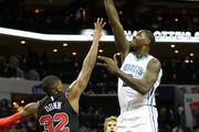 Marvin Williams #2 of the Charlotte Hornets shoots over Kris Dunn #32 of the Chicago Bulls during their game at Spectrum Center on February 27, 2018 in Charlotte, North Carolina.  NOTE TO USER: User expressly acknowledges and agrees that, by downloading and or using this photograph, User is consenting to the terms and conditions of the Getty Images License Agreement.
