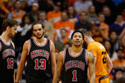 Pau Gasol #16, Joakim Noah #13 and Derrick Rose #1 of the Chicago Bulls during the NBA game against the Phoenix Suns at US Airways Center on January 30, 2015 in Phoenix, Arizona. The Suns defeated the Bulls 99-93.  NOTE TO USER: User expressly acknowledges and agrees that, by downloading and or using this photograph, User is consenting to the terms and conditions of the Getty Images License Agreement.