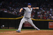 Jon Lester #34 of the Chicago Cubs delivers a first inning pitch against the Arizona Diamondbacks at Chase Field on August 12, 2017 in Phoenix, Arizona.