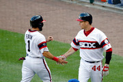 Adam Eaton #1 of the Chicago White Sox is congratulated by Justin Morneau #44 after scoring on an RBI single hit by Jose Abreu #79 (not pictured) against the Chicago Cubs during the first inning at U.S. Cellular Field on July 26, 2016 in Chicago, Illinois.