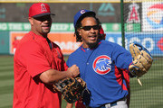 Hitting consultant Manny Ramirez #99 of the Chicago Cubs is greeted by first baseman Albert Pujols #6 of the Los Angeles Angels of Anaheim before the game at Angel Stadium of Anaheim on April 5, 2016 in Anaheim, California.