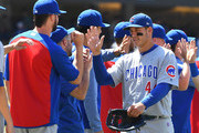 Anthony Rizzo #44 of the Chicago Cubs gets high fives as he walks off the field after defeating the Los Angeles Dodgers at Dodger Stadium on June 28, 2018 in Los Angeles, California.