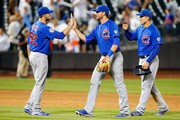 Justin Grimm #52, Kris Bryant #17 and Anthony Rizzo #44 of the Chicago Cubs celebrate after defeating the New York Mets at Citi Field on July 1, 2015 in the Flushing neighborhood of the Queens borough of New York City.