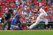 Matt Holliday #7 of the St. Louis Cardinals hits the game-winning, two-run single in the eighth inning against the Chicago Cubs at Busch Stadium on August 31, 2014 in St. Louis, Missouri.  The Cardinals beat the Cubs 9-6.