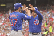 Kris Bryant #17 and Anthony Rizzo #44 of the Chicago Cubs celebrate scoring on a Chris Coghlan #8 (not pictured) single in the fifth inning during a baseball game against the Washington Nationals at Nationals Park on June 7, 2015 in Washington, DC.
