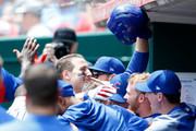 Anthony Rizzo #44 of the Chicago Cubs is congratulated by his teammates after hitting a two-run home run during the fifth inning of the game against the Cincinnati Reds at Great American Ball Park on June 24, 2018 in Cincinnati, Ohio. Cincinnati defeated Chicago 8-6.