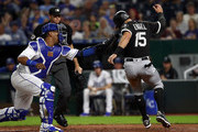 Catcher Salvador Perez #13 of the Kansas City Royals tags out Adam Engel #15 of the Chicago White Sox at home plate during the 3rd inning of the game at Kauffman Stadium on September 12, 2018 in Kansas City, Missouri.