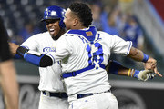 Alcides Escobar (L) of the Kansas City Royals celebrates with Salvador Perez #13  after his sacrifice bunt scored Brian Goodwin to give them a 4-3 win over the Chicago White Sox in ten innings at Kauffman Stadium on September 10, 2018 in Kansas City, Missouri.