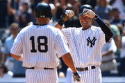 Johnny Damon #18 of the New York Yankees is congratulated by team mate Derek Jeter #2 after hitting a two run homer in the third inning against the Chicago White Sox during their game on August 30, 2009 at Yankee Stadium in the Bronx borough of New York City.