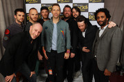 L-R Guy Berryman, Richard Jupp, Will Champion, Jonny Buckland, Chris Martin, Guy Garvey, Craig Potter and Pete Turner of Coldplay and Elbow pose backstage at Children In Need Rocks Manchester 2011 at The Manchester Evening News Arena on November 17, 2011 in Manchester, United Kingdom.