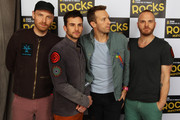 L-R Jonny Buckland, Guy Berryman, Chris Martin and Will Champion of Coldplay pose backstage at Children In Need Rocks Manchester 2011 at The Manchester Evening News Arena on November 17, 2011 in Manchester, United Kingdom.