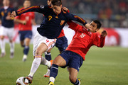 Fernando Torres of Spain fends off Gonzalo Jara of Chile during the 2010 FIFA World Cup South Africa Group H match between Chile and Spain at Loftus Versfeld Stadium on June 25, 2010 in Tshwane/Pretoria, South Africa.