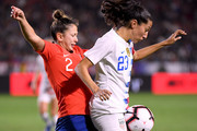 Christen Press #23 of United States controls the ball away from Rocio Soto #2 of Chile during a 3-0 United States win at StubHub Center on August 31, 2018 in Carson, California.