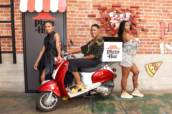 Pizza Hut Lounge At 2019 Comic-Con International: San Diego [scooter,motor vehicle,red,vehicle,vespa,fashion,automotive design,street fashion,photography,street,nafessa williams,christine adams,china anne mcclain,l-r,black lightning,pizza hut lounge,san diego,california,comic-con international: san diego]