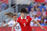 Wang Shanshan #9 of China controls the ball against Tobin Heath #17 of the United States in the first half in the FIFA Women's World Cup 2015 Quarter Final match at Lansdowne Stadium on June 26, 2015 in Ottawa, Canada.