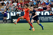 SANDY UT- JUNE 07: Wang Shuang #7 of China directs the ball away from Becky Sauerbrunn #4 of the United States in the first half of an international friendly soccer match at Rio Tinto Stadium on June 7, 2018 in Sandy, Utah.