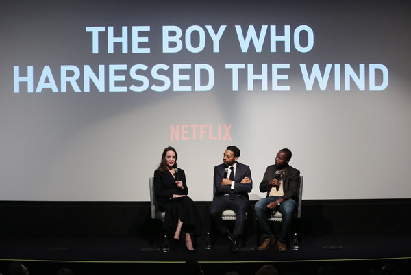 'The Boy Who Harnessed The Wind' Special Screening, Hosted By Angelina Jolie [angelina jolie,william kamkwamba,chiwetel ejiofor,the boy who harnessed the wind special screening,text,sky,font,design,event,adaptation,talent show,team,performance,brand,crosby street hotel,new york city]