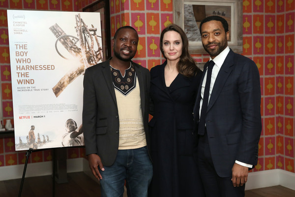 'The Boy Who Harnessed The Wind' Special Screening, Hosted By Angelina Jolie [angelina jolie,chiwetel ejiofor,william kamkwamba,the boy who harnessed the wind special screening,event,award,adaptation,award ceremony,suit,formal wear,employment,crosby street hotel,new york city]