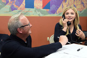 Volunteer Kavin Burkhalter (L) of Nevada looks on as actress Chloe Grace Moretz makes phone calls at a campaign office for Democratic presidential candidate Hillary Clinton on February 19, 2016 in Las Vegas, Nevada. Clinton is challenging Sen. Bernie Sanders for the Democratic presidential nomination ahead of Nevada's February 20th Democratic caucus.