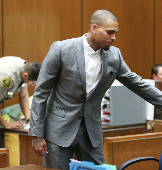 Recording artist Chris Brown appears in Los Angeles Superior Court on February 28, 2014 in Los Angeles, California.  Brown has been on probation since pleading guilty to assaulting his then girlfriend, singer Rihanna, after a pre-Grammy Awards party in 2009. He has been in anger management treatment program and performing community service requirements.  Brown and his bodyguard Christopher Hollosy are also facing misdemeanor simple assault charges after from an incident outside the W hotel in Washington D.C. last October