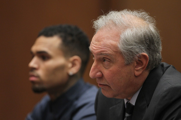Chris Brown Attorney Mark Geragos (R) and client R&B singer Chris Brown appears in court for a probation progress hearing for Brown on February 3, 2014 in Los Angeles, California. Brown has been on probation since pleading guilty to assaulting his then girlfriend, singer Rihanna, after a pre-Grammy Awards party in 2009. He has been in anger management treatment program and performing community service requirements but failure to meet probation requirements could be even further complicated by assault charges he and bodyguard Christopher Hollosy face stemming from an incident outside the W hotel in Washington D.C. last October.
