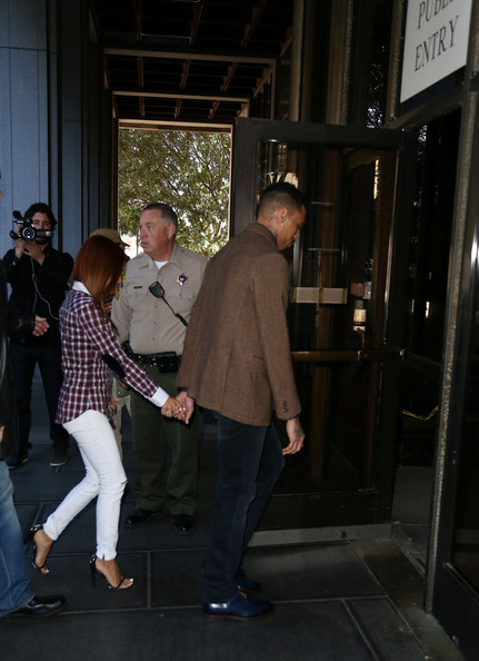 Chris Brown Recording artist Chris Brown and Karrueche Tran enter the Los Angeles Courthouse on February 3, 2014 in Los Angeles, California.  Brown has been on probation since pleading guilty to assaulting his then girlfriend, singer Rihanna, after a pre-Grammy Awards party in 2009. He has been in anger management treatment program and performing community service requirements but failure to meet probation requirements could be even further complicated by assault charges he and bodyguard Christopher Hollosy face stemming from an incident outside the W hotel in Washington D.C. last October.