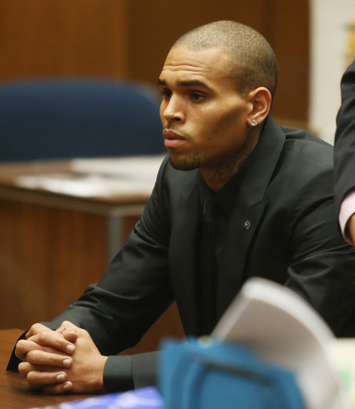 Recording artist Chris Brown appears in Los Angeles court on November 20, 2013 in Los Angeles, California.  Brown was ordered to 90 days at an inpatient center, random drug testing and 24 hours of weekly community service.  Brown was arrested last month for misdemeanor assault in Washington, DC and was already on probation for a felony domestic violence charge after a 2009 incident with then-girlfriend Rihanna.